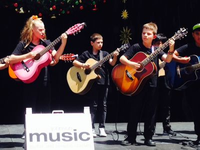 Guitarists Perform at Pacific Square Community Event