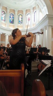 Director, Madeline Procopio performing solo with a Sydney Orchestra