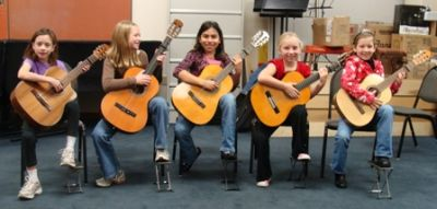 Some of our kids enjoying the guitar!