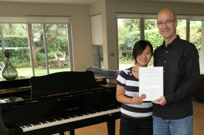 Dr Li Li, successful on being awarded her AMusA Piano Diploma on her first attempt.