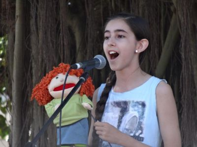 Youth vocal student performing in outdoor event in Cairns